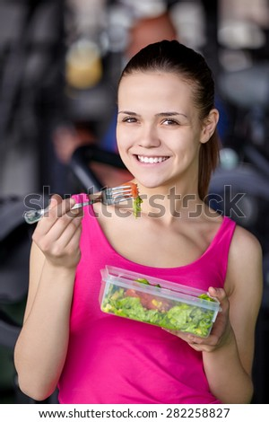 Healthy young woman eating salad - stock photo