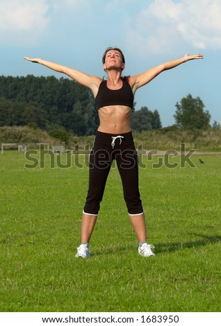 healthy young woman is doing a workout in the park - stock photo
