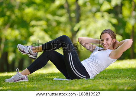 healthy young woman stretching before Fitness and Exercise - stock photo