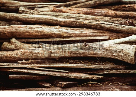 Heap of aged brown wooden logs as a natural background. - stock photo
