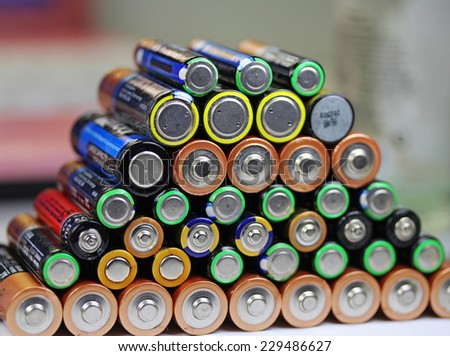 Heap of alkaline batteries - stock photo