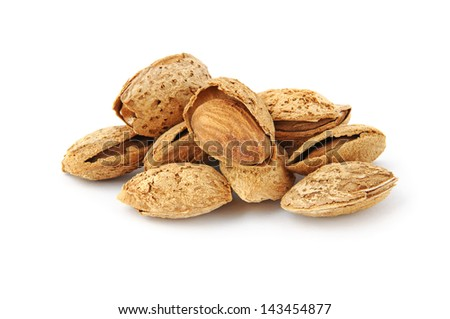 Heap of almond nuts in shell isolated on white - stock photo