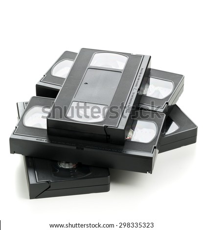 Heap of analog video home system (VHS) tape over white background - stock photo