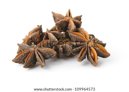 Heap of anise stars on white background with shadow - stock photo