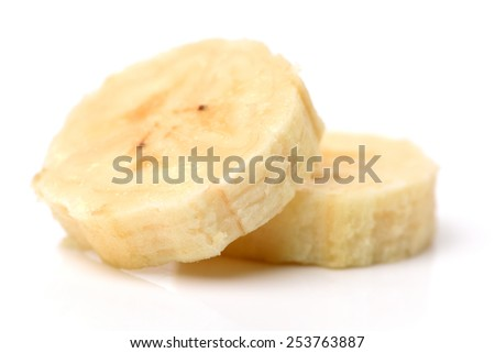 Heap of banana slices on a white background - stock photo