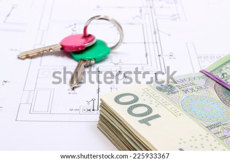 Heap of banknotes and home keys lying on construction drawing of house, concept of building house - stock photo