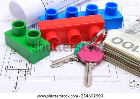 Heap of banknotes, home keys, plastic building blocks and rolled electrical diagrams lying on construction drawing of house, concept of building house, drawings for the projects engineer jobs - stock photo
