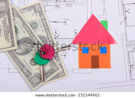 Heap of banknotes, house of colored paper and home keys on construction drawing of house, concept of building home - stock photo