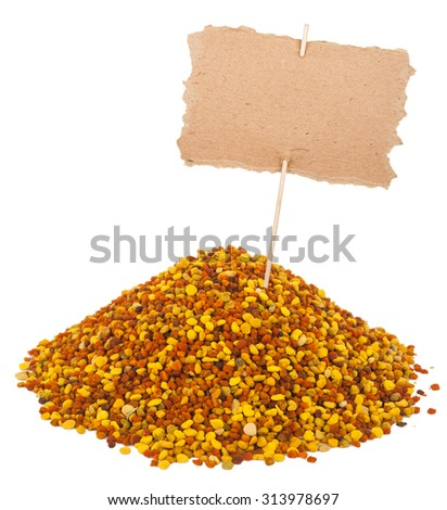 Heap of bee pollen with a pointer - stock photo