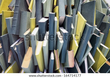 heap of blank books - chaos - stock photo