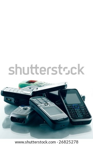 Heap of blue toned phones - stock photo