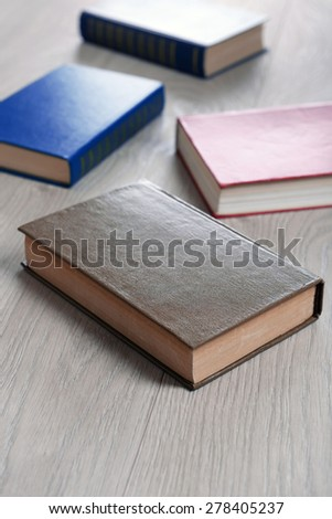 Heap of books on wooden background - stock photo