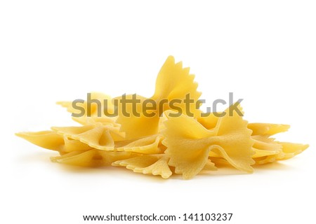 heap of bow tie pasta on white background - stock photo