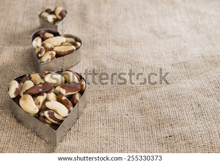 Heap of Brazil Nuts (close-up shot) on wooden background - stock photo