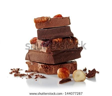Heap of broken chocolate on white background - stock photo