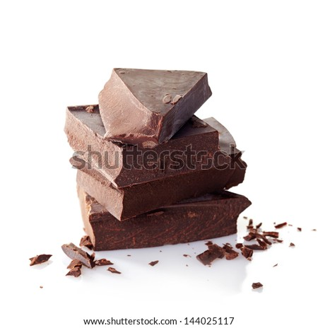 Heap of broken pieces of chocolate on white background - stock photo