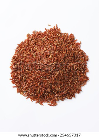Heap of Camargue red rice (Grown organically in the wetlands of Southern France) - stock photo