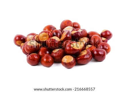 Heap of chestnuts on a white background - stock photo