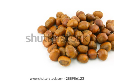 heap of chestnuts on white background - stock photo