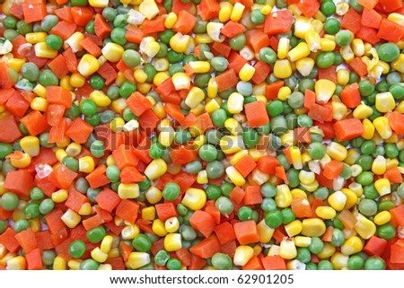Heap of Chop carrot pea and corn using as background - stock photo