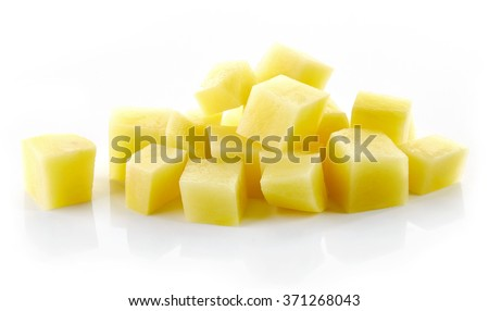 heap of chopped raw potatoes isolated on white background - stock photo