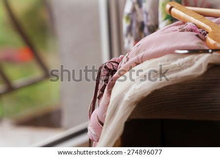 Heap of clothes on  chair - stock photo