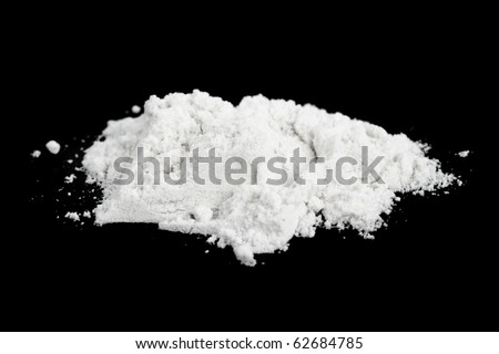 Heap of cocaine isolated on black background - stock photo