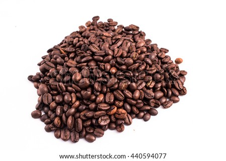 Heap of coffee beans in the background. Texture of the coffee beans on a white background. Smelly, saturated brown arabic coffee beans - stock photo