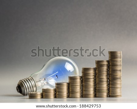 Heap of coins stairs with light bulb for financial plan or business idea concept - stock photo