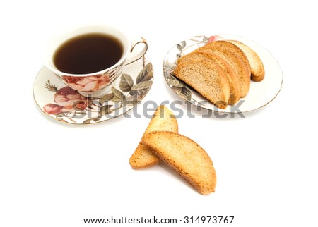 heap of crackers and cup of tea on white - stock photo