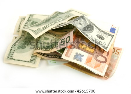 Heap of crumpled dollar and euro bills on white  background - stock photo