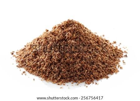 heap of crushed flax seeds isolated on white background - stock photo