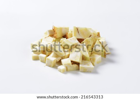 heap of cubed celery on white background - stock photo