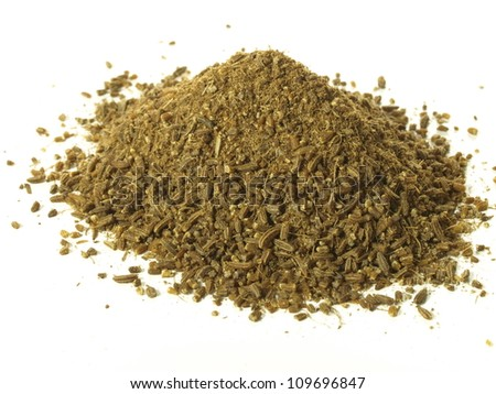 Heap of cumin on isolated white background - stock photo
