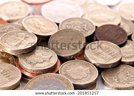 Heap of different british pound sterling coins. Macro - stock photo