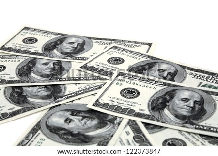 heap of dollar banknotes on a white background - stock photo