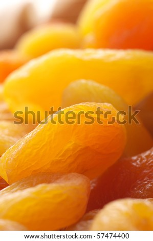 Heap of dried apricots close-up as background. - stock photo