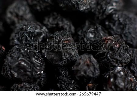 Heap of dried Aronia berries. - stock photo