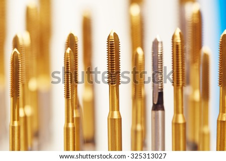 heap of finished metal thread tap tools with protective coating, Shallow DOF - stock photo