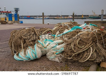 Heap of Fishing Nets Background - stock photo