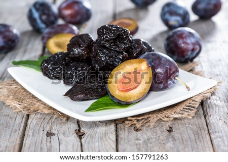 Heap of fresh dried Plums - stock photo