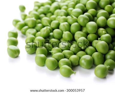 Heap of fresh green peas isolated on white - stock photo
