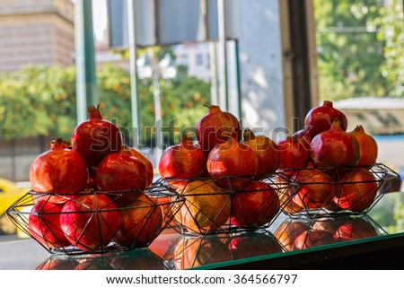Heap of fresh pomegranates in the stores - stock photo