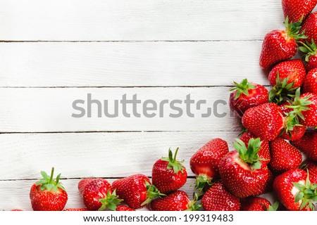 Heap Of Fresh Red Ripe Strawberries On White Board - stock photo