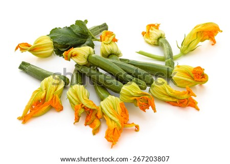 Heap of fresh zucchini with flowers. Isolated on white background. - stock photo