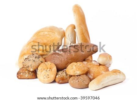 Heap of freshly baked bread on white background - stock photo