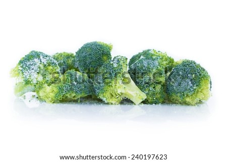 Heap of frozen broccoli isolated - stock photo