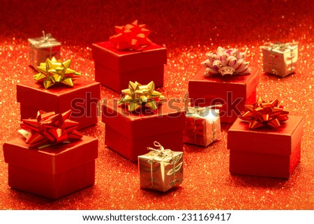 heap of gift boxes on glitter background - stock photo