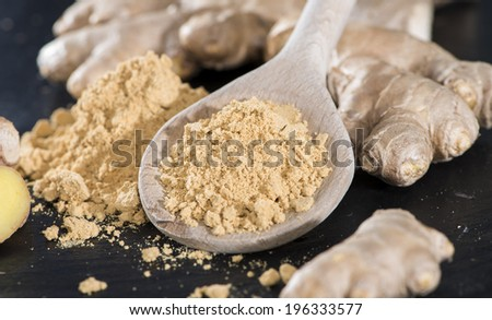 Heap of ginger Powder (detailed close-up shot) - stock photo
