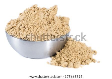Heap of Ginger Powder isolated on white background - stock photo